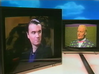 File:Mhcom s3e06 max david byrne switched.jpg